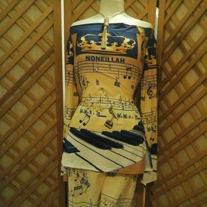 Noneillah gold and blue signature music note shirt